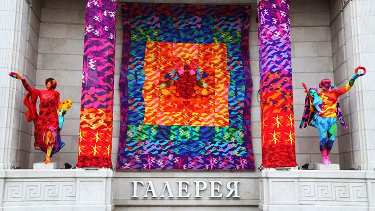 "Olek Crochets Rainbow Yarn Installation On Building Facade in St. PetersburgAccording to the artist, the installation's rainbow theme stands for ""love, freedom, friendship, independence, liberty, ability to pursue dreams, integrity, and equal rights."""