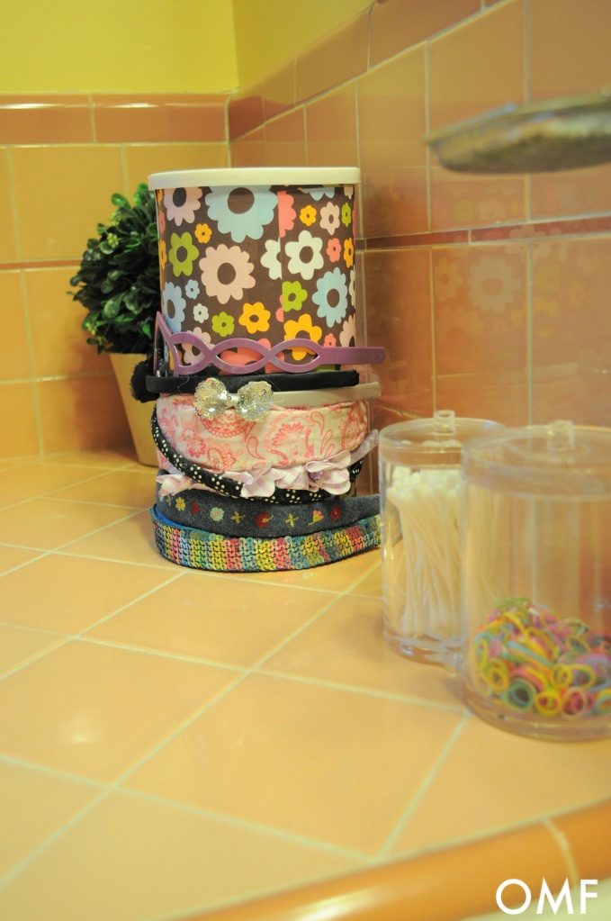 Use empty oatmeal container for headbands around the outside and all the other stuff on the inside!