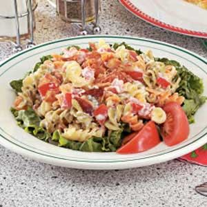 BLT pasta salad—lettuce, pasta, bacon, and tomatoes. Easy lunch.