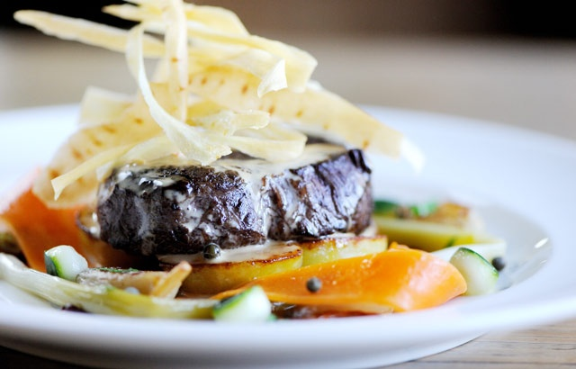 Beef fillet with roasted shallots, sauté potatoes and green peppercor ...