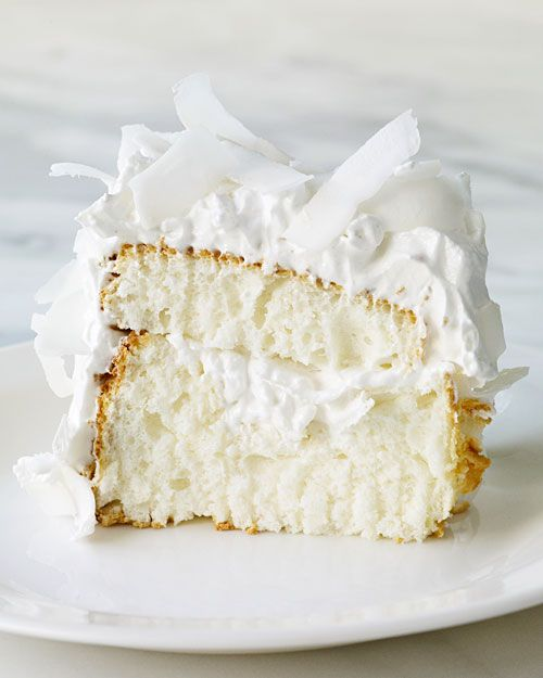 Coconut Cloud Cake...This light, flavorful dessert, filled and topped with seven-minute frosting and coconut, is a little slice of heaven