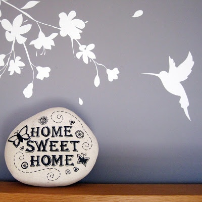 Decorated stone featuring the phrase Home sweet home