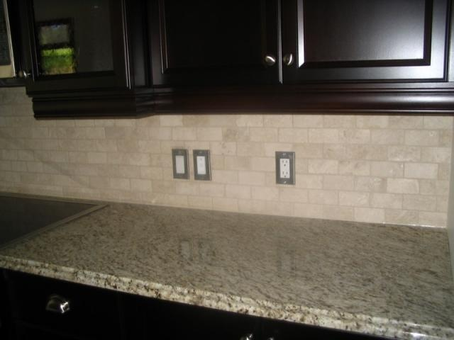 dark cabinets stone backsplash and granite countertops great