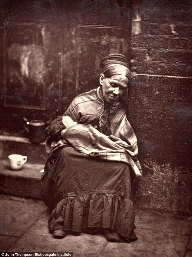 Why having a social safety net is the right thing to do . . . The woman featured in the picture was the widow of a tailor. She sits on a stone step wearing a headscarf, a long skirt and a striped shawl.   She holds a young child in her arms and is looking after it while its mother works at a nearby coffee shop.In exchange for caring for the child, the old woman will get a cup of tea and a slice of bread. circa 1876-1877