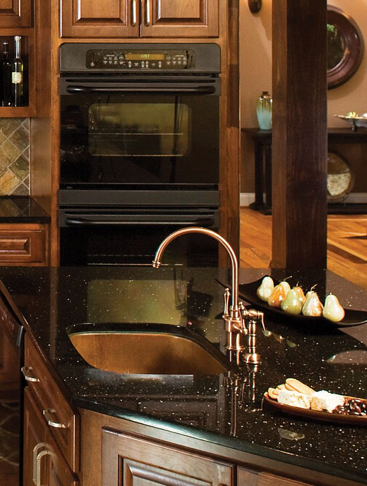 Luxe Matallics in the kitchen of the Amherst Plan #753