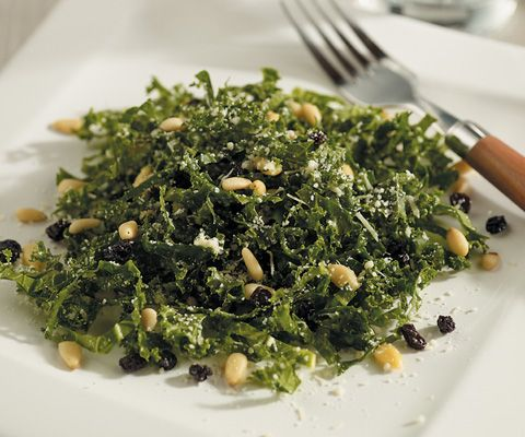 pine nuts kale salad with pine nuts currants and parmesan recipe
