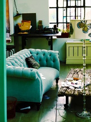 Aqua velvet Chesterfield sofa!  I like the butterfly lamp as well... (; and the room isn't clean it has a lived in touch.