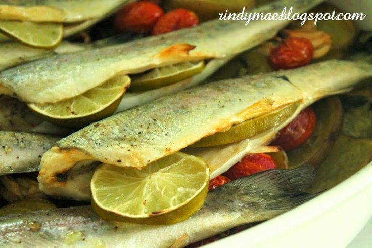 Oven Baked Trout with Garlic, Potatoes, and Tomatoes