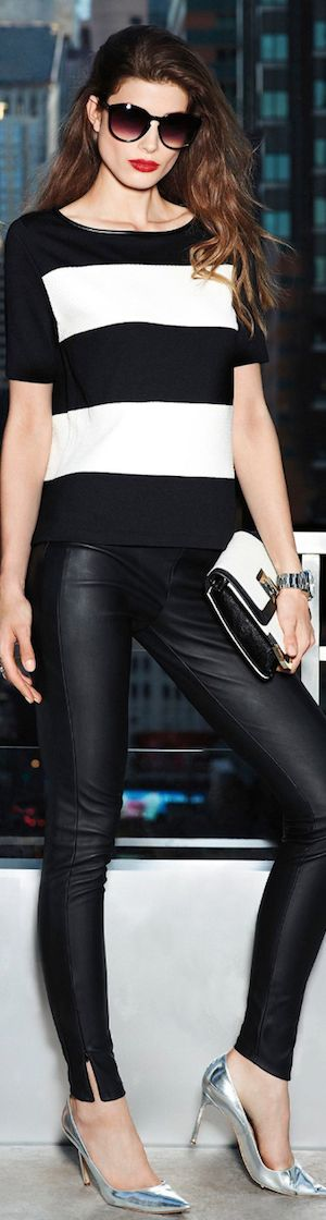 black and white Tshirt leather pants with silver high heel shoes