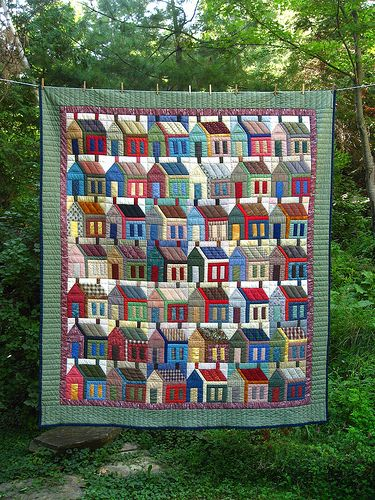 Wow! Such rich colours and beautiful details. Hand quilted.