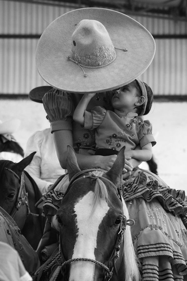 All things Mexico.Escaramuza Riders Women with honor, courage, strength, tradition and family in one Mexican Sport. The conjunction of rider and horse as one unit combine to become a complete team.Beauty and color, fast movement, risk and spectacular emotion. These are some of the photos of  these extraordinary Mexican women in action that impress me. I chose black and white to amplify the essence of their soul.    (Escaramuza Riders by Emilio Garcia Salazar)