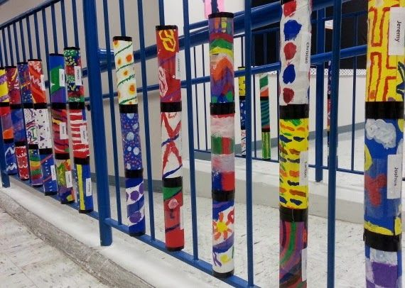 Recycled Cardboard Tubes painted for decorative stair railing