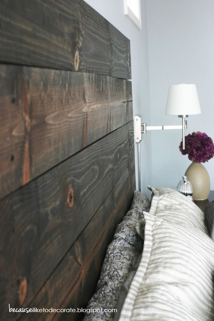 Headboard made from stained 2x4s, each is individually drilled into the wall.