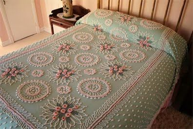 My grandmother had chenille bedspreads like this in all the bedrooms of her house. *happy nostalgic sigh* I really want at least one for my own someday.