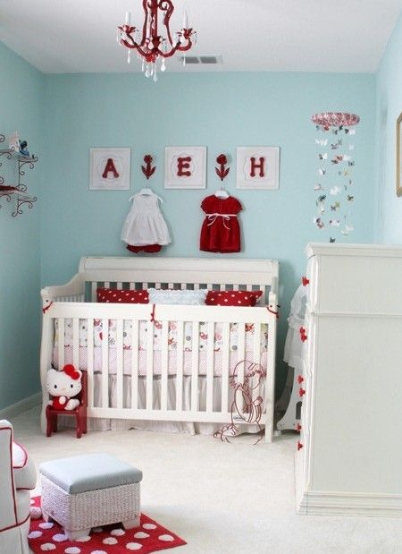Aqua nursery with red pops of color
