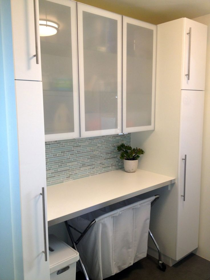 fresh laundry - ikea kitchen cabinets, glass and marble tile ...