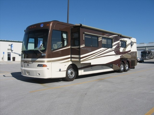 2009 Holiday Rambler Scepter   Four slides, bath and a half, tag axle, Aqua-hot and more.  http://www.buyandsellrvs.com/details.cfm?adv_id=1058697_token=CC50B06D-180E-450A-86FF-F3F985835586
