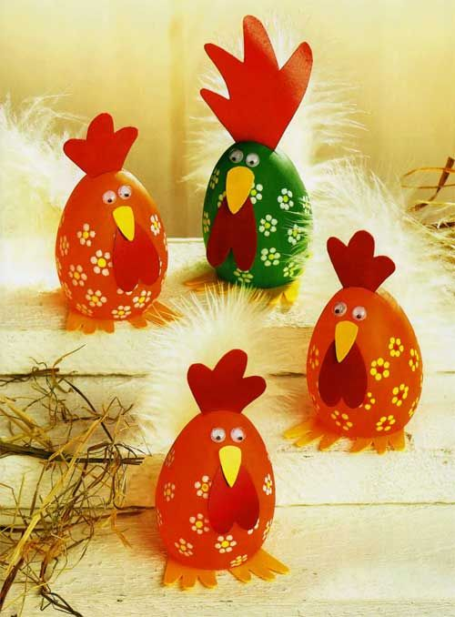 DIY crafts for Easter: these are Paper and bright red and green eggs dressed up like roosters