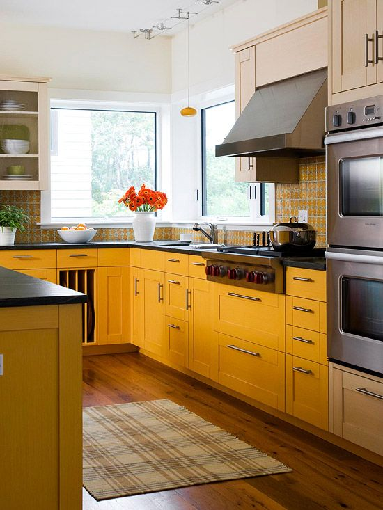 For a sunny feel, the lower cabinets are painted a mustard