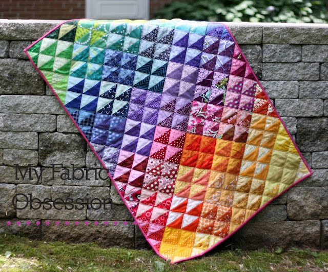 Half Square Triangles and rainbow colored quilt!
