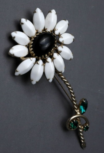 "Large Vintage Black Centered White Daisy Brooch. $34.99 on GoAntiques. Large Vintage Black Centered White Daisy Brooch. It is of milk glass navettes surrounding a jet black glass oval cabochon. The stem is a twisted gold tone metal that features faceted green rhinestones. It measures 3 7/8"" long and the head of the flower is almost 2"" wide. The condition is excellent. #vintage #jewelry"