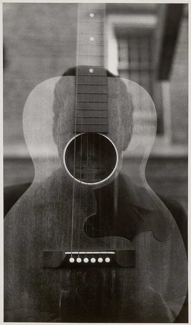 Untitled (Self-Portrait with Camera and Guitar), 1955, by Ralph Eugene Meatyard