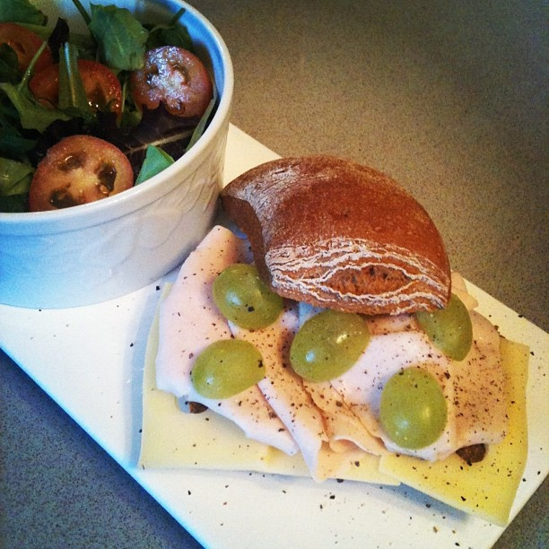 Rye sandwich with turkey salami, Swiss cheese, white grapes and black ...