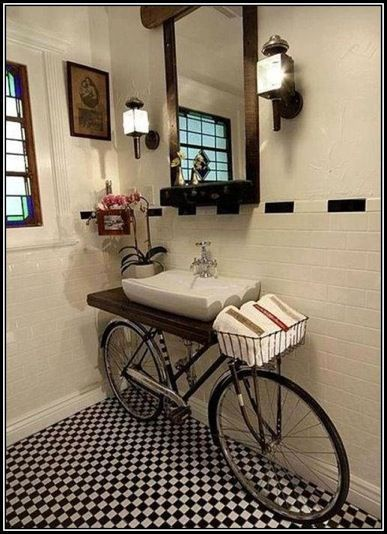 Creative idea to use a bike as a home decor, especially the basket as a place to hold things.