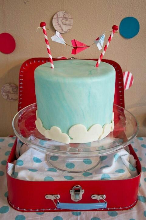 Adoption shower cake - airplane theme - lemon truffle cake with white chocolate ganache, blue swirl marshmallow fondant, white fondant clouds and a mini paper airplane garland
