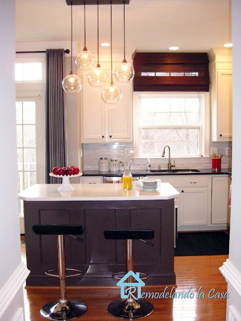 Love the staggered pendant lights and grey/white combo for a kitchen