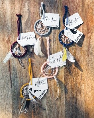 With help from her sister and groom-to-be, Sarah crafted mini dream catchers for escort cards. View more of the bride's dreamy details by clicking the link.