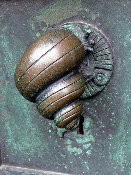 Ribe Cathedral. Portal Door handle in form of a snail (1904) by Anne Marie Carl-Nielsen