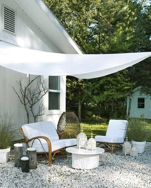 Triangular canvas umbrella overhang home architecture for Architecture upbrella