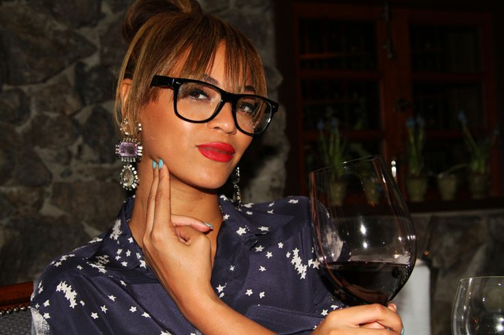 Beyonce rocks statement earrings and geeky glasses. LOVE