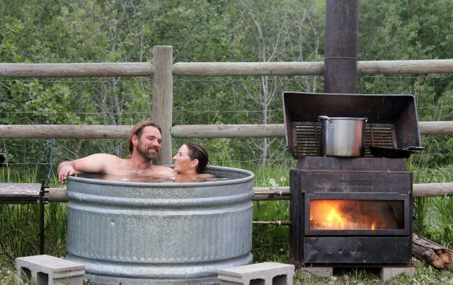 Build shed useful diy wood fired hot tub plans for Outdoor bathtub wood fired