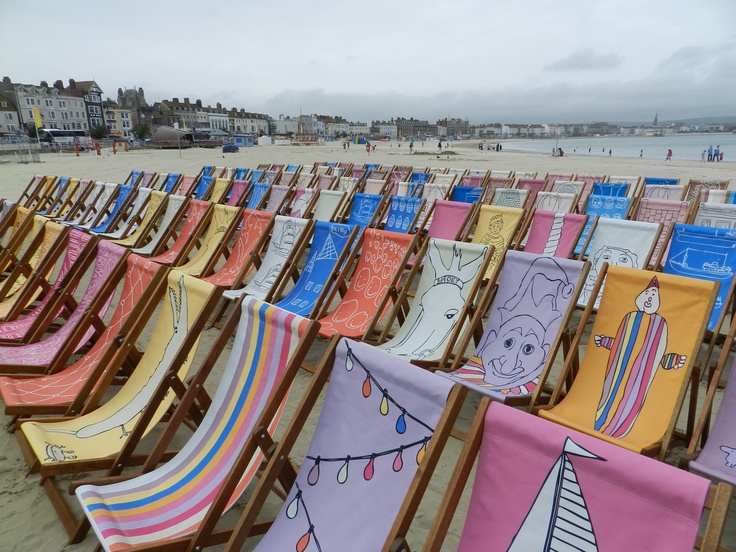 A different view of the deck chairs at the community deck chair project lunch event looking down Weymouth Beach. (c) Reay Scenics 2012.