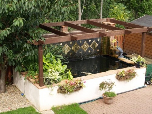 Raised fish ponds my dream home pinterest for Raised fish pond ideas