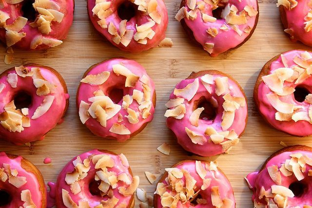 Pink Raised Doughnuts with Toasted Coconut - via joy the baker