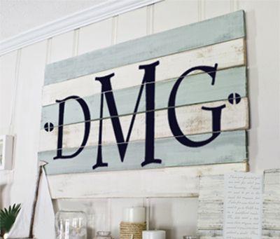 Simple Vinyl Monogram applied to distressed wood boards.