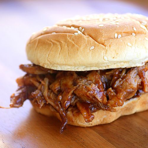 Place a 2-lb pork tenderloin in a slow cooker, pour a 12-oz can of root beer over it and cook on high for 6 hours. Discard juice, cover pork with 1 18-oz jar bbq sauce and heat until sauce is warm. Serve on buns.    1 (18 ounce) bottle of barbecue sauce
