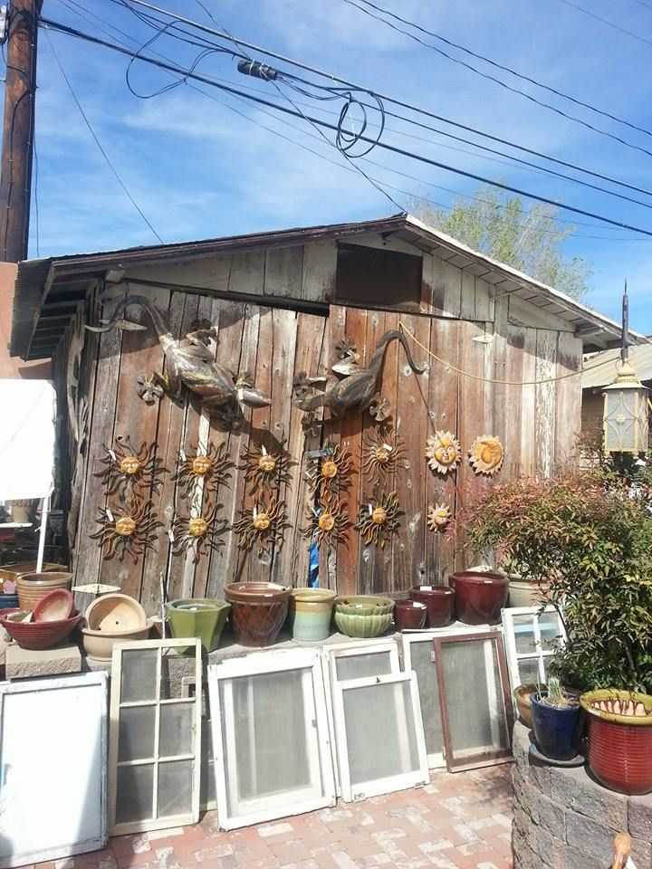 Windows and metal sculptures at santa fe trading co in victorville