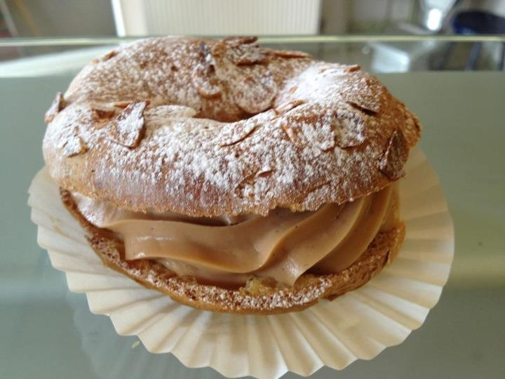 ... Choux pastry bun filled a praline cream, topped with toasted almonds