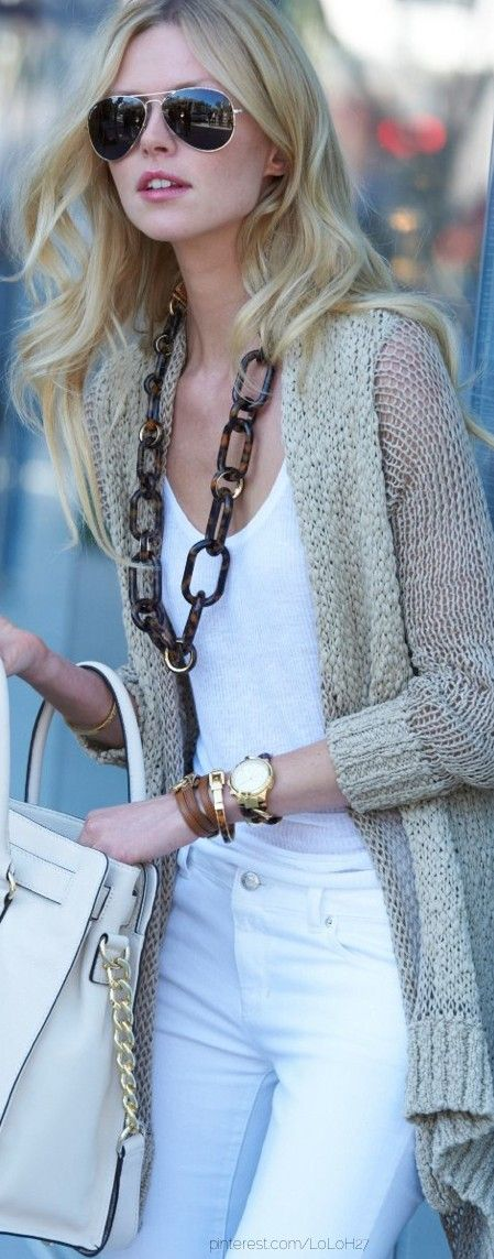all-white with a chunky open cardi and statement necklace