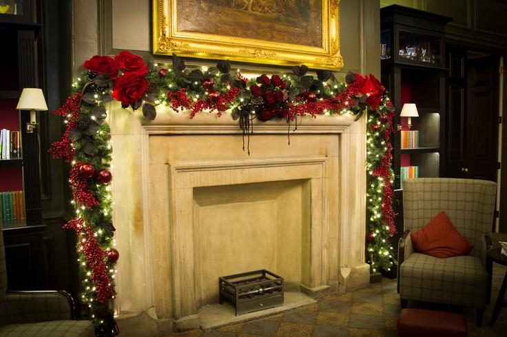 Fireplace garland christmas pinterest for Christmas garland on fireplace