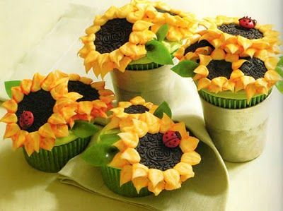 These are my favorite cupcakes to make from the cookbook Hello, Cupcake!  Sunflowers and ladybugs, you can't go wrong.