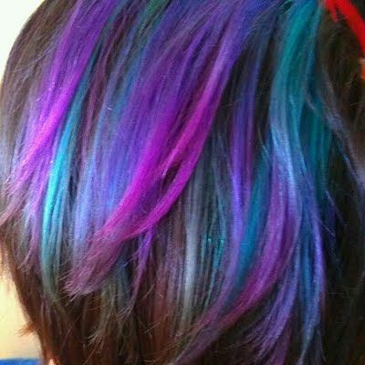 ... turquoise and plum tones together to create this gorgeous hair color