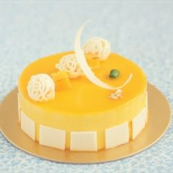 mango cheese mousse cake with spiced pineapple coulis, mango caramel ...