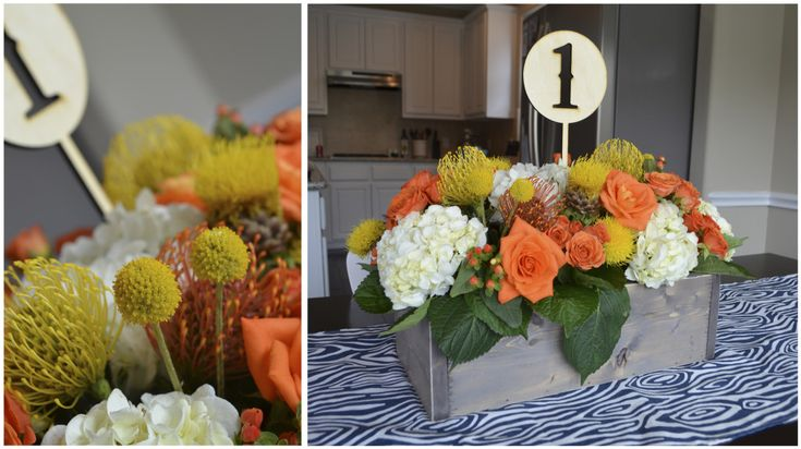 Gorgeous floral centerpiece - love the pop of orange and rustic!