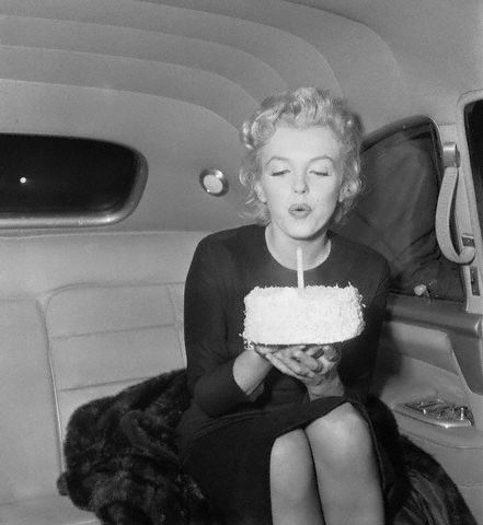 marilyn Monroe blowing out her candles on her 30th Birthday