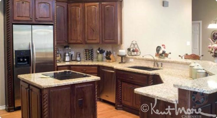 Cabinets by Kent Moore Cabinets Rustic Hickory Wood with Burnt Sienna